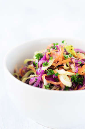 Coleslaw a healthy vibrant colourful salad made with shredded raw cabbage, carrots and onions