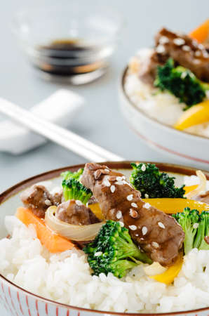 stir up: Close up on beef stir fry with vegetables on steamed white rice Stock Photo
