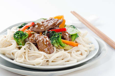 Chinese noodles with beef strips and stir fried vegetables, oriental cuisine photo