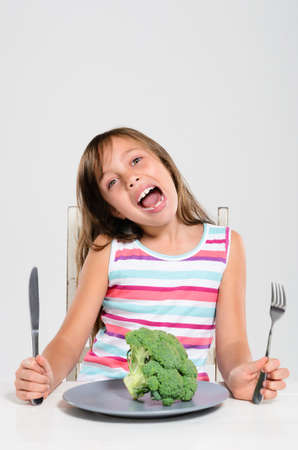 Portrait of young girl happy at meal time to eat her fresh vegetables, healthy eating concept Stock Photo - 17191858