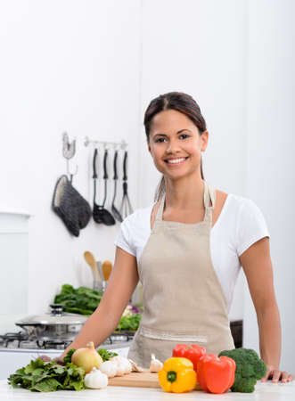 Happy smiling woman in kitchen with fresh produce vegetables preparing for a healthy meal Stock Photo - 17686971