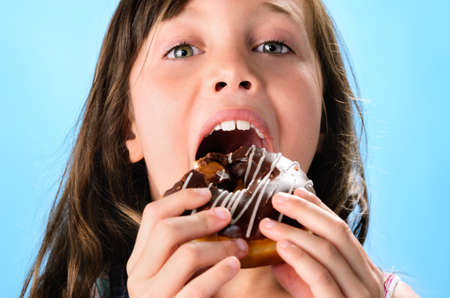 Portrait of adorable cute girl kid with donut Stock Photo - 18286262