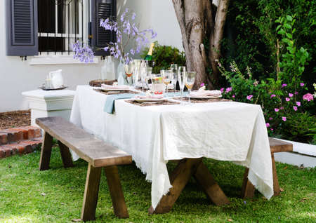 Table setting for an outdoor garden party with neutral nude color scheme photo