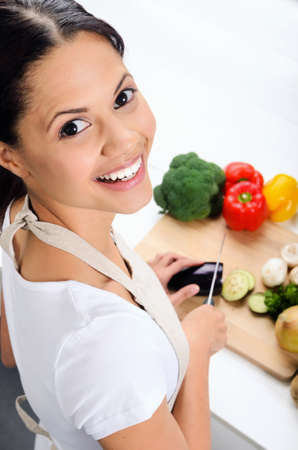 Close up portrait of mix race woman cooking and preparing food in the kitchen  Stock Photo - 20309854