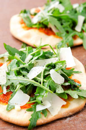 mini oven: Mini pizzas with fresh rocket and shaved parmesan cheese Stock Photo