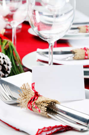 Christmas holiday dinner setting in red and white theme with empty place card, copy space Stock Photo - 20668712