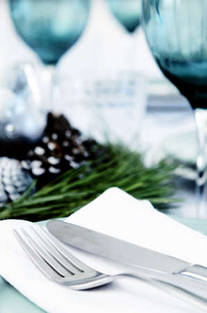 Place setting cutlery and blue glasses for christmas with pine cone centerpiece Stock Photo - 20669945