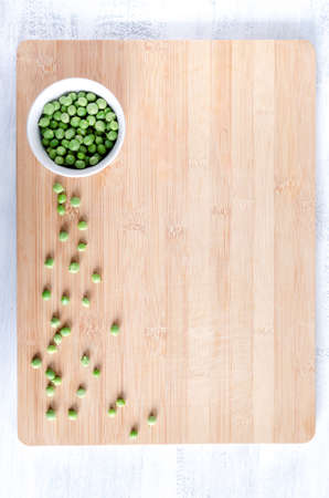 vegetable fresh peas on bamboo chopping board from overhead, food background photo