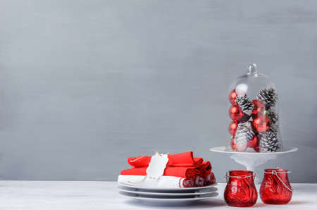 Modern christmas decoration table display in simple, elegant, minimalist style with lots of copy space, glass dome or cloche for xmas ornaments photo