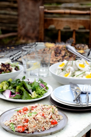 Table full of side dishes, variety assortment of salads for a party gathering in the garden outdoors photo