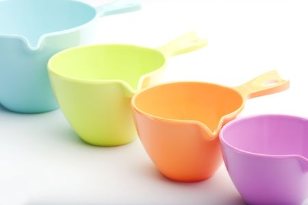 Close-up Of Four Plastic Measuring Cups photo