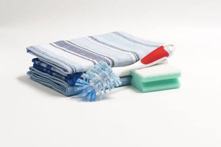 A Washing Up Brush, Scouring Pad and Three Folded Drying Cloths Banco de Imagens