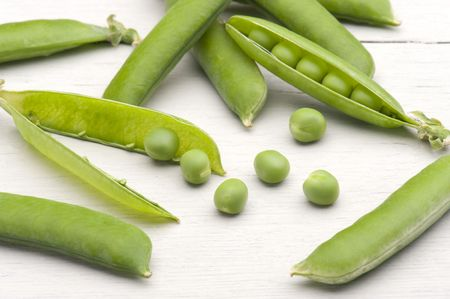 freshly picked: Freshly Picked Garden Peas On A Kitchen Table