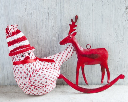 christmas robin: Two Christmas Decoration, A Robin and A Deer, On A Wooden Shelve Stock Photo