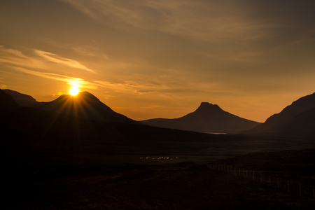 highland: Sunset over Coigach and the unmistakeable Stac Pollaidh, Scottish Highlands.