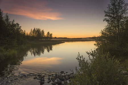 noiseless: Sunset on calm and noiseless lake in Finland. Stock Photo