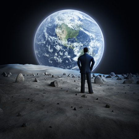 Man standing on the moon, looking at the Earth 写真素材