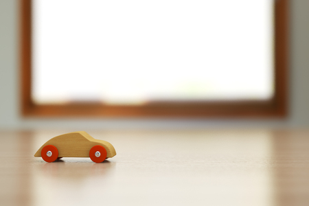 Wooden toy car on the table.