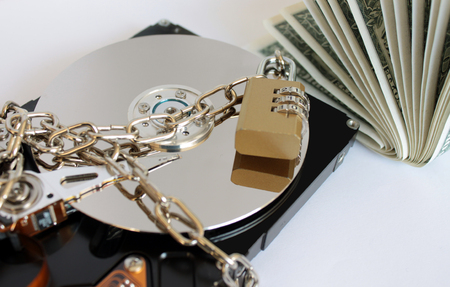 Information security concept. The data is a locked hard drive. The concept of paying money to save the data.
