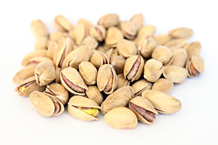 Organic salted pistachios on a white background