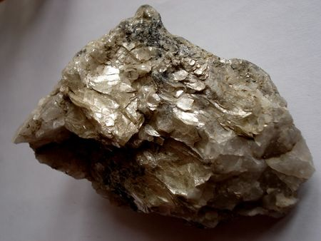 A piece of quartz richly impregnated with mica, isolated with clipping path