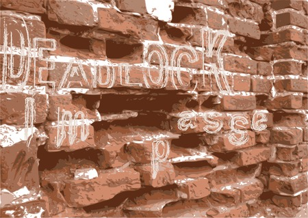 Close-up of an age-old brick wall with a depressive inscription