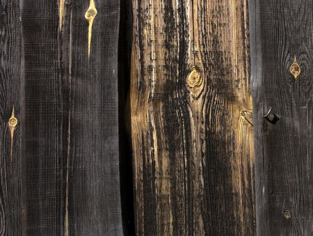 Old planks with yellow knots photo