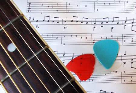 accoustic: Guitar fretboard, picks and music
