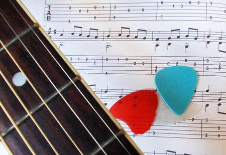 Guitar fretboard, picks and music