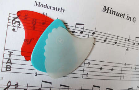 accoustic: Guitar picks on music page