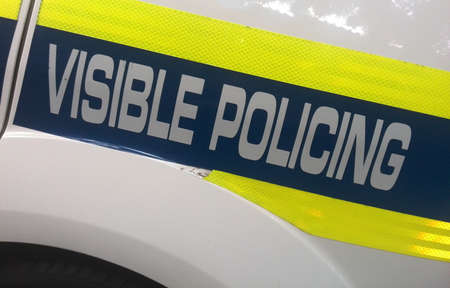 policing: Close up of police car visible policing logo Stock Photo