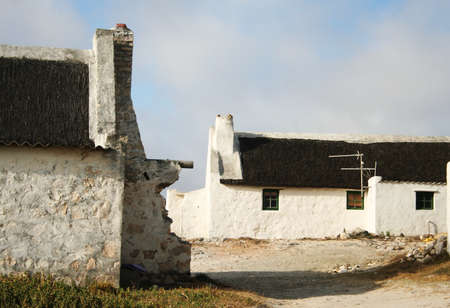 thatch: Rustic thatch roof seaside cottages Stock Photo