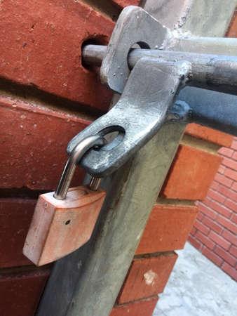 lockup: close up of securely locked entrance gate