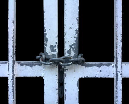 prison bars: close up of prison bars metal door locked with chain