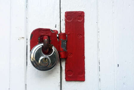 lock: stainless steel lock with red latch Stock Photo