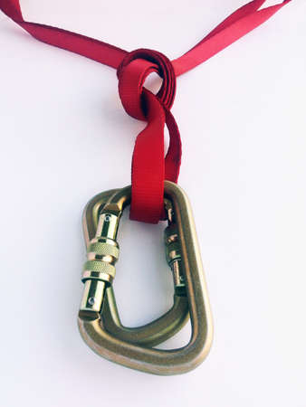 rappel: red slings tied to two carabiners with an overhand knot