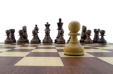 Chess pieces - white pawn looking down the chessboard