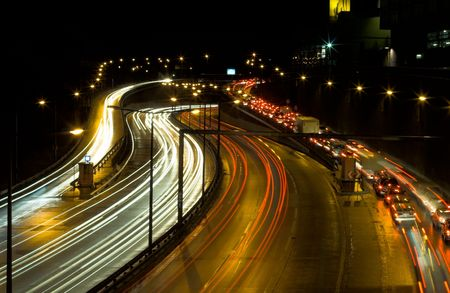 Highway traffic at night - long time exposure was used to show car movements.