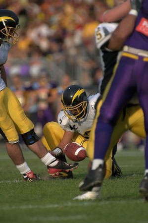 Punting the ball. The photo was taken during the EFL Final 2006 Paris Flash vs. Dodge Vikings. Stock Photo