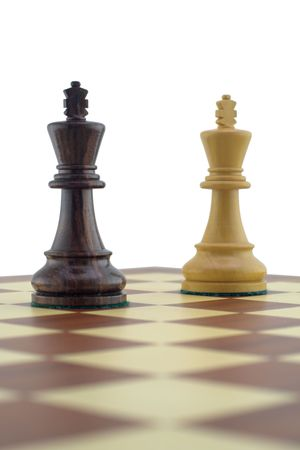 Chess pieces - white and black king photo