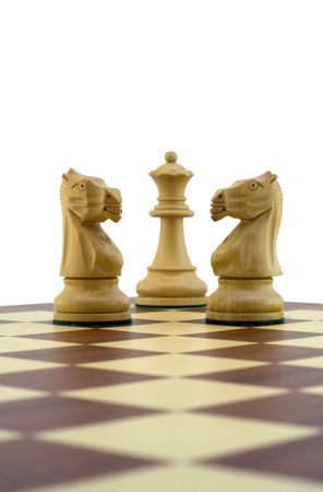 Chess pieces - two white knights guarding the queen Stock Photo - 888389