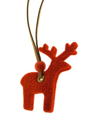 Christmas Decoration - a red reindeer is isolated on a pure white background. photo