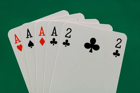 four of a kind: Poker hand - Four of a kind - (isolated with a clipping path). Stock Photo