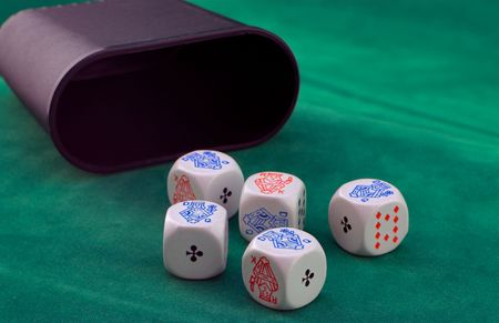four of a kind: Poker dice on green felt, showing four of a kind.