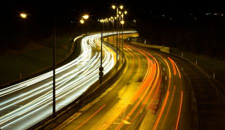 Highway traffic at night - long time exposure was used to show car movements. Stock Photo - 890478