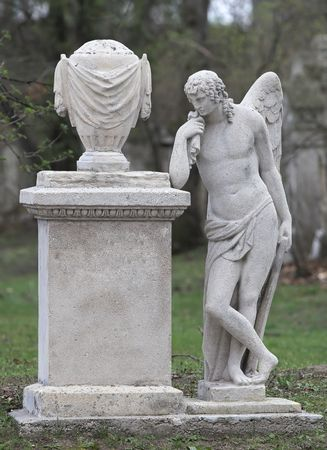 Picture of a stone angel on a grave stone. A clipping path is included to extract the statue from the background. Stock Photo - 890489