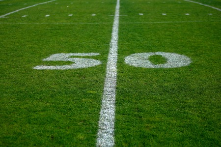 Photo of the fifty yards line on a football field. Stock Photo