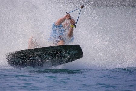 Photo of a wake boarder in a tight turn.