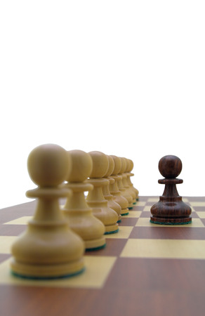 Chess pieces - black pawn in front of a row of white pawns. Stock Photo - 1667558
