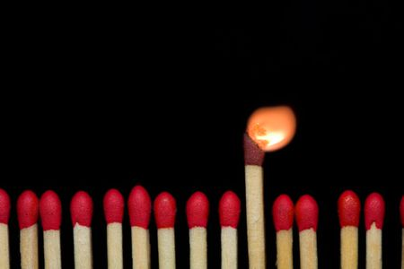 A row of matches, with one of them burning. Stock Photo - 2027317